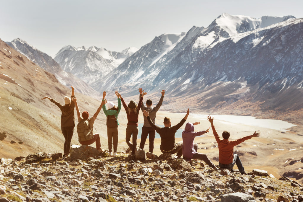 Big active company of happy friends in mountains