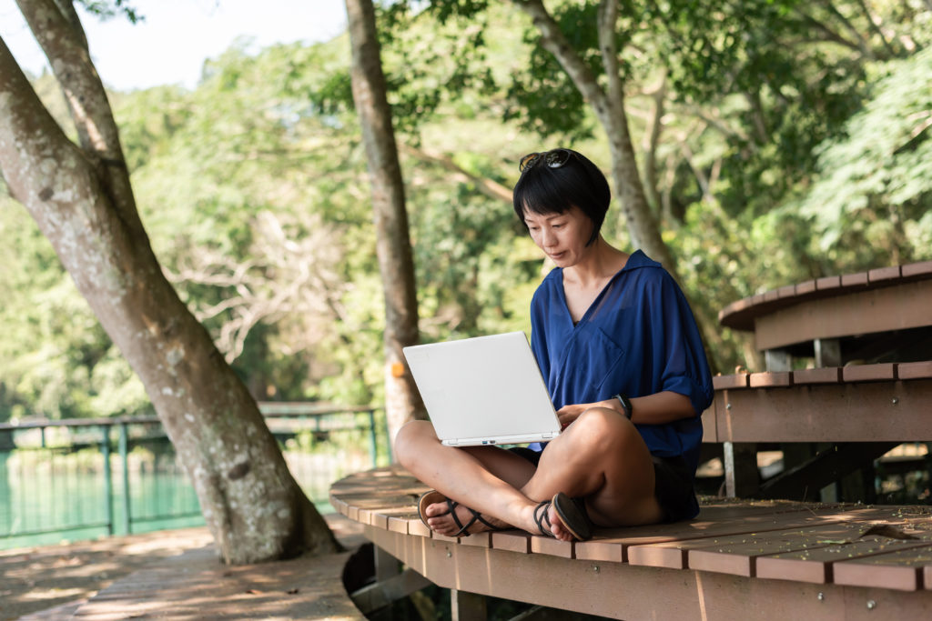 woman using laptop, concept of working at outdoor